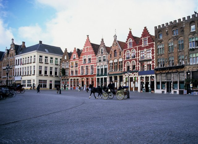 The colourful historic market square of Bruges, Belgium.